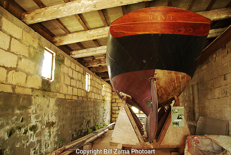 Vintage British Racing Sloop Dainty up in dry storage at the Royal Naval Dockyard in Bermuda.