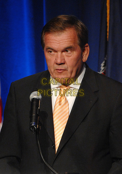 "GOVERNOR TOM RIDGE .speaks at the ""9/11 We Will Never Forget"" Dinner held at Heinz Field East Club. A Night to Remember The Heroes of Flight 93 that went down on September 11, 2001 in Shanksville, PA, USA, 11th September 2009..9 11 nine eleven half length on stage  black suit orange striped tie microphone .CAP/ADM/JLN.©Jason L Nelson/Admedia/Capital Pictures"