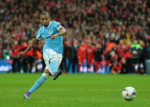 28.02.2016. Wembley Stadium, London, England. Capital One Cup Final. Manchester City versus Liverpool. Manchester City Midfielder Fernandinho scores from the penalty spot during the shoot out