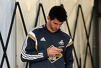 SWANSEA, WALES - MAY 02: Nelson Oliveira of Swansea on his phone prior to the Premier League match between Swansea City and Stoke City at The Liberty Stadium on May 02, 2015 in Swansea, Wales. (photo by Athena Pictures/Getty Images)