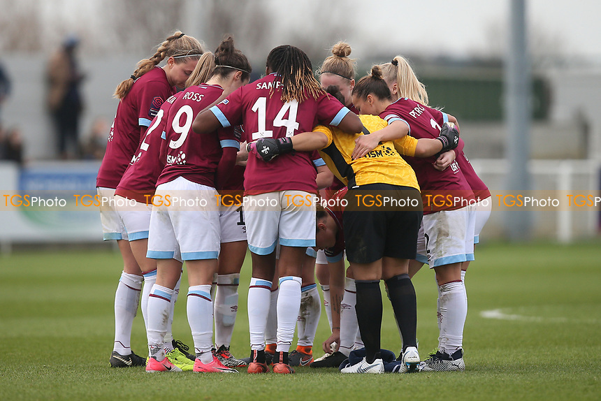West Ham players huddle during West Ham United Women vs Arsenal Women, FA Women's Super League Football at Rush Green Stadium on 6th January 2019