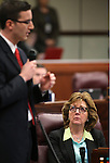 Nevada Assemblywoman Marilyn Dondero Loop, D-Las Vegas, listens as Assemblyman Wesley Duncan, R-Las Vegas, speaks on the Assembly floor during historic proceedings at the Legislative Building in Carson City, Nev., on Thursday, March 28, 2013. .Photo by Cathleen Allison