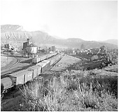 North-looking view of D&amp;RGW Durango yard with many freight cars.  #375's tender showing in distance almost behind water tank.<br /> D&amp;RGW  Durango, CO