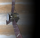 NASA's Juno spacecraft is shown in orbit above Jupiter's colorful clouds in this artist's rendering. Launching from Earth in 2011, the Juno spacecraft will arrive at Jupiter in 2016 to study the giant planet from an elliptical, polar orbit. Juno will repeatedly dive between the planet and its intense belts of charged particle radiation, coming only 5,000 kilometers (about 3,000 miles) from the cloud tops at closest approach. Juno's primary goal is to improve our understanding of Jupiter's formation and evolution. The spacecraft will spend a year investigating the planet's origins, interior structure, deep atmosphere and magnetosphere. Juno's study of Jupiter will help us to understand the history of our own solar system and provide new insight into how planetary systems form and develop in our galaxy and beyond. .Credit: NASA/JPL-Calrech via CNP