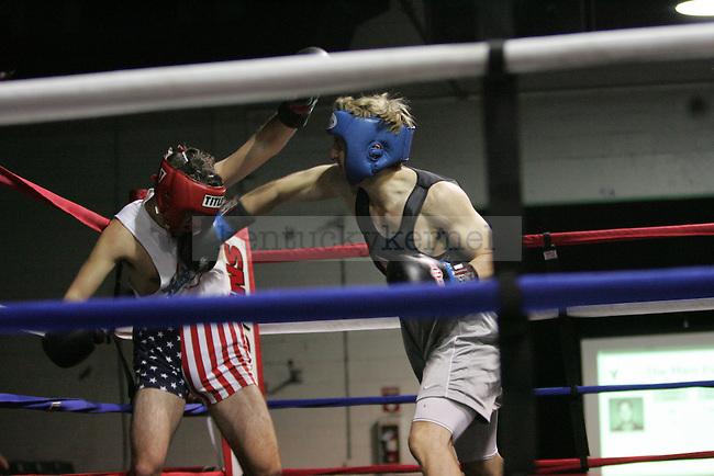 Frankie Giovetti (R) of Sigma Chi punches Charles Griffith (L) of Beta at The Main Event, where proceeds benefitted The Huntsman Cancer Institute and The Ronald McDonald House in Lexington, Ky. on 11/11/11. Photo by Quianna Lige | Staff