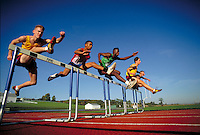 Competitors cross hurdles in track meet. Track hurdlers. Harrisburg Pennsylvania United States.