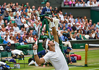 London, England, 01 July, 2016, Tennis, Wimbledon, Juan Martin Del Potro (ARG) serves in his match against Stanislas Wawrinka (SUI) on the chair: Umpire Mohamed Lahyani<br /> Photo: Henk Koster/tennisimages.com
