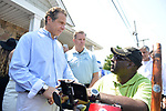 Massapequa, New York, USA. August 5, 2018. Gov. ANDREW CUOMO, running for re-election, speaks with disabled man asking for government action helping the handicapped. The governor was a special guest at opening of joint campaign office for Grechen Shirley and NY Sen. J. Brooks, aiming for a Democratic Blue Wave in November midterm elections.