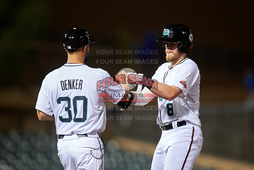 Salt River Rafters Seth Beer (8), of the Arizona Diamondbacks organization, is congratulated by first base coach Travis Denker (30) after hitting a double during an Arizona Fall League game against the Mesa Solar Sox on September 27, 2019 at Salt River Fields at Talking Stick in Scottsdale, Arizona. Salt River defeated Mesa 6-1. (Zachary Lucy/Four Seam Images)