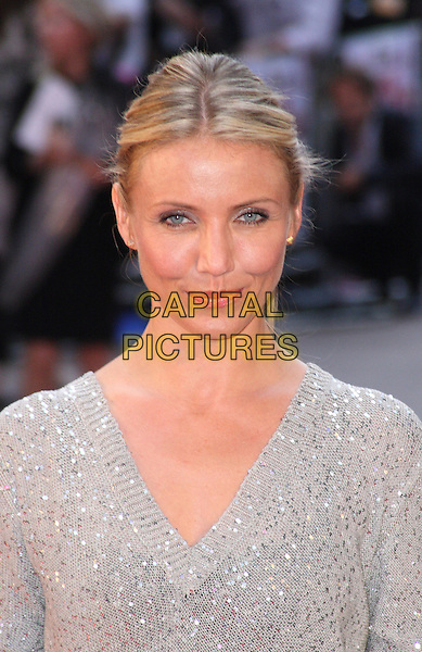 CAMERON DIAZ .The UK Premiere of 'Knight and Day' at the Odeon, Leicester Square, London, England, UK, July 22nd 2010.portrait headshot  grey gray sequined sequin silver sweater jumper v-neck  knitted hair up make-up .CAP/JIL.©Jill Mayhew/Capital Pictures