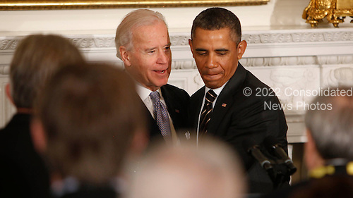 United States Vice President Joseph Biden greets United States President Barack Obama before the President speaks to the National Governors Association in the State Dining Room of the White House in Washington, D.C. on February 25, 2013.  .Credit: Dennis Brack / Pool via CNP
