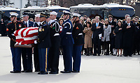 Former President George W. Bush watches as the flag-draped casket of former President George H.W. Bush is carried by a joint services military honor guard to Special Air Mission 41, Wednesday, Dec. 5, 2018, at Andrews Air Force Base, Md.<br /> CAP/MPI/RS<br /> &copy;RS/MPI/Capital Pictures