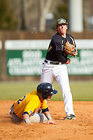 TJ Nichting (1) of the Charlotte 49ers makes a throw to first base as Ronnie Bernick (2) of the Canisius Golden Griffins slides into second base at Hayes Stadium on February 23, 2014 in Charlotte, North Carolina.  The Golden Griffins defeated the 49ers 10-1.  (Brian Westerholt/Four Seam Images)