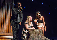 Emcees Edward Jackson '16 and Marielle Peña Rosario '16 talk with Linneen Warren '16 as she touches the tree stump for luck. Occidental College students perform at the annual Apollo Night talent show, hosted by the Black Student Alliance, in Thorne Hall, Friday, Feb. 21, 2014. 15 acts performed a variety of music and dance. (Photo by Marc Campos, Occidental College Photographer)