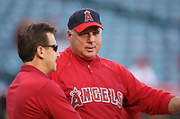 ANAHEIM - OCTOBER 8:  Owner Arte Moreno and manager Mike Scioscia of the Los Angeles Angels of Anaheim watch batting practice before Game 1 of the American League Division Series against the Boston Red Sox at Angel Stadium on October 8, 2009 in Anaheim, California. Photo by Brad Mangin