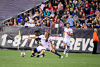 September 9, 2017 - Foxborough, Mass: New England Revolution midfielder Gershon Koffie (5) wraps up Montreal Impact midfielder Samuel Piette (29) during the MLS game between the Montreal Impact and the New England Revolution held at Gillette Stadium in Foxborough Massachusetts. Revolution defeat Impact 1-0. Eric Canha/CSM
