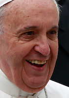 Papa Francesco sorride al termine dell'udienza generale del mercoledi' in Piazza San Pietro, Citta' del Vaticano, 9 aprile 2014.<br /> Pope Francis smiles at the end of his weekly general audience in St. Peter's Square at the Vatican, 9 April 2014.<br /> UPDATE IMAGES PRESS/Isabella Bonotto<br /> <br /> STRICTLY ONLY FOR EDITORIAL USE