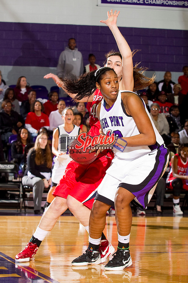 Cheyenne Parker #42 of the High Point Panthers looks to pass the ball while being defended by Ema Reskoska #42 at Millis Athletic Center on February 4, 2012 in High Point, North Carolina.  The Highlanders defeated the Panthers 66-61.   (Brian Westerholt / Sports On Film)