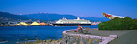 Alaska Bound Cruise Ship departing Port of Vancouver Harbour, past SS Empress of Japan Figurehead and Stanley Park Seawall, BC, British Columbia, Canada - North Vancouver and Grouse Mountain beyond, Panoramic View