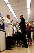 Bethesda, MD - September 30, 2009 -- United States President Barack Obama speaks with Dr. Francis Collins (L) and  Dr. Marston Linehan (2L) during a laboratory tour with Secretary of Health and Human Services (HHS) Kathleen Sebelius (R) at the National Institute of Health in Bethesda, Maryland, Wednesday, September 30, 2009. After the visit, President Obama will make a major announcement regarding the American Recovery and Reinvestment Act  at the National Institutes of Health..Credit: Aude Guerrucci / Pool via CNP