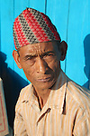 There are many people of Nepalese origin in neighbouring Sikkim. This man wears a traditional Nepalese topi,  or cap.
