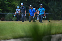 Justin Rose (GBR), Patrick Reed (USA), and Henrik Stenson (SWE) head down 12 during Round 3 of the Zurich Classic of New Orl, TPC Louisiana, Avondale, Louisiana, USA. 4/28/2018.<br /> Picture: Golffile | Ken Murray<br /> <br /> <br /> All photo usage must carry mandatory copyright credit (&copy; Golffile | Ken Murray)