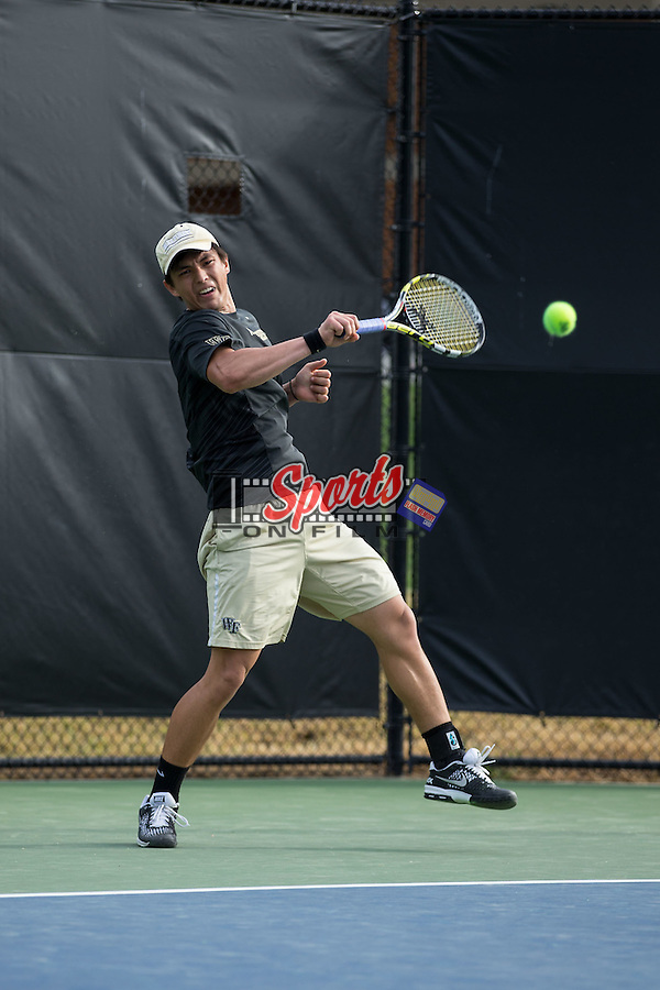 Maksim Kan of the Wake Forest Demon Deacons returns the ball during his singles match against the North Carolina Tar Heels at the Wake Forest Tennis Center on April 11, 2015 in Winston-Salem, North Carolina.  The Demon Deacons defeated the Tar Heels 4-3.    (Brian Westerholt/Sports On Film)