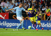 Thursday 08 August 2013<br /> Pictured: Wayne Routledge of Swansea (R) challenged by Pontus Jansson (L) of Malmo<br /> Re: Malmo FF v Swansea City FC, UEFA Europa League 3rd Qualifying Round, Second Leg, at the Swedbank Stadium, Malmo, Sweden.