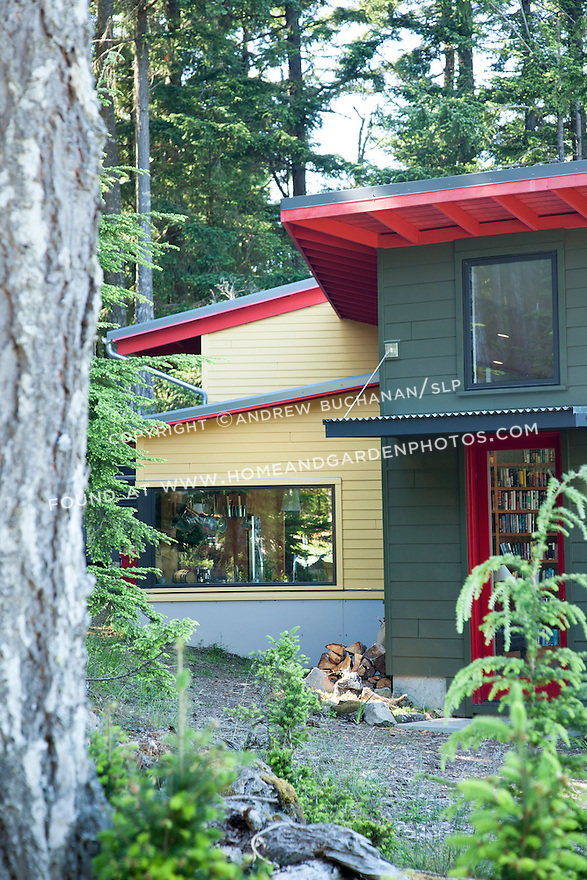 Bright red and yellow make this house stand out from the surrounding trees. This image is available through an alternate architectural stock image agency, Collinstock located here: http://www.collinstock.com