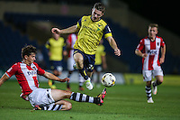 Dan Crowley of Oxford United rides a Jordan Storey of Exeter City tackle during the The Checkatrade Trophy match between Oxford United and Exeter City at the Kassam Stadium, Oxford, England on 30 August 2016. Photo by Andy Rowland / PRiME Media Images.