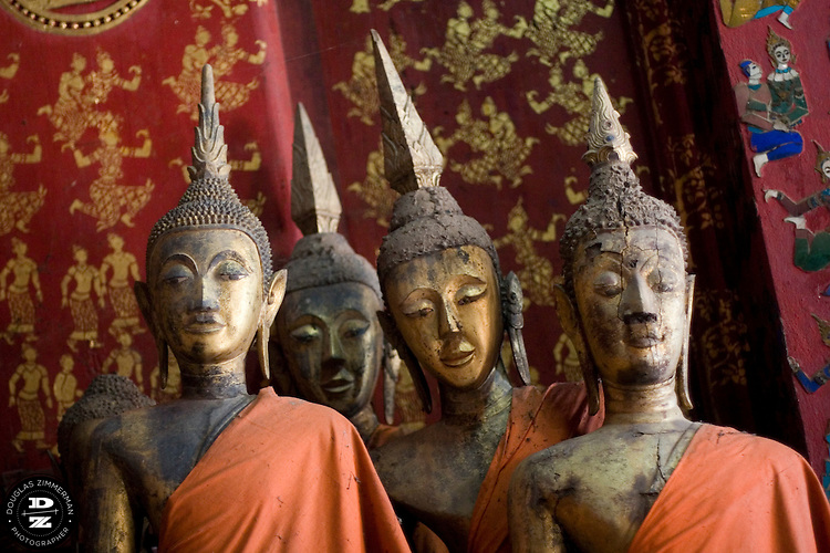 Several buddhist statues in a buddhist temples at Haw Kham (Royal Palace) complex in Luang Prabang, Laos. Photograph by Douglas ZImmerman.