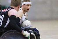 27 MAY 2013 - DONCASTER, GBR - Aaron Phipps (right) of the South Wales Pirates looks for a way through the West Coast Crash defence during the 2013 Great Britain Wheelchair Rugby Nationals bronze medal match at The Dome in Doncaster, South Yorkshire .(PHOTO (C) 2013 NIGEL FARROW)