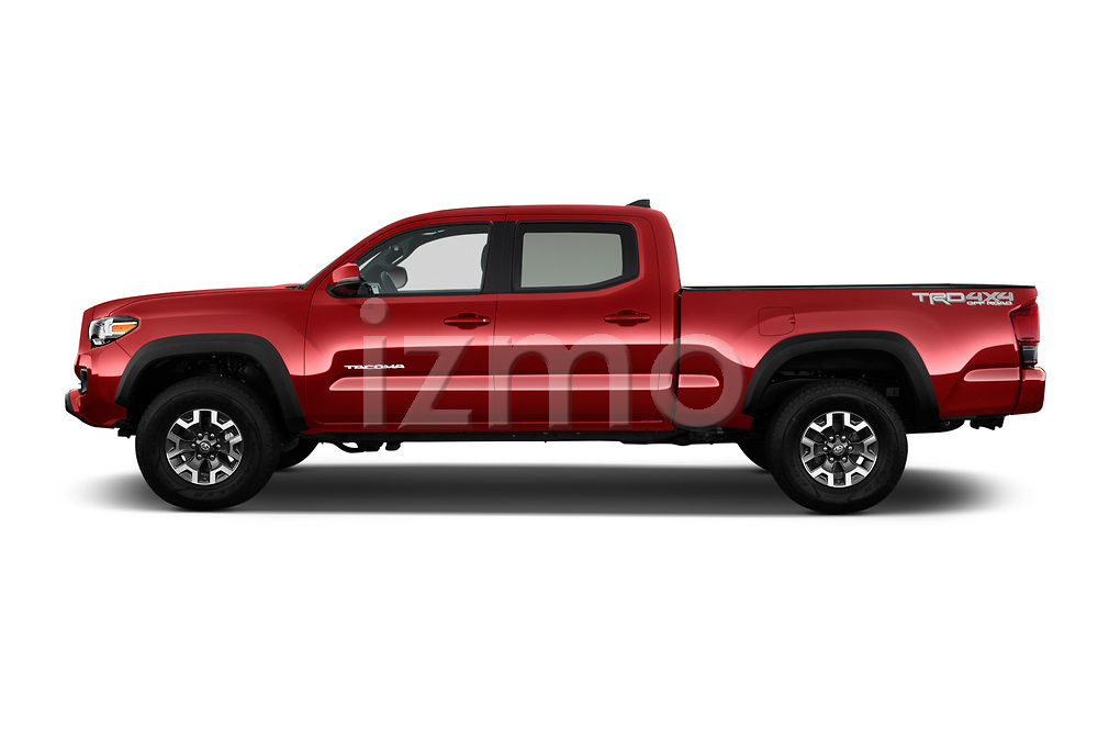 Car driver side profile view of a 2016 Toyota Tacoma TRD Off Road Double 4 Door Pick Up