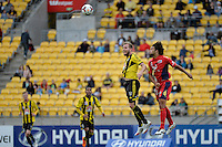 Jeremy Brockie and Osama Malik during the A League - Wellington Phoenix v Adelaide United, Wellington, New Zealand on Sunday 30 March 2014. <br /> Photo by Masanori Udagawa. <br /> www.photowellington.photoshelter.com.
