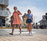 UK Weather: Aberystwyth, Ceredigion, West Wales Thursday 12th May 2016. <br />Two young University students stroll by the promenade
