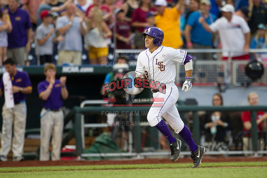 LSU Tiger first baseman Mason Katz (8) jogs around the bases after hitting a home run in the fourth inning of Game 4 of the 2013 Men's College World Series against the UCLA Bruins on June 16, 2013 at TD Ameritrade Park in Omaha, Nebraska. UCLA defeated LSU 2-1. (Andrew Woolley/Four Seam Images)