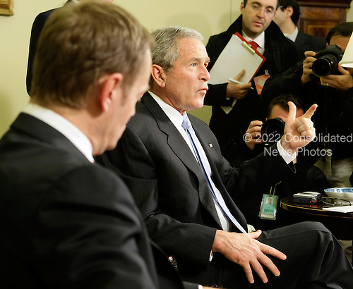 Washington, DC - March 10, 2008 -- United States President George W. Bush (R) speaks to the media as Polish Prime Minister Donald Tusk (L) looks on during a meeting at the Oval Office of the White House March 10, 2008 in Washington, DC. Tusk is in Washington to discuss with Bush on the inclusion of Poland in a U.S. build missile defense system.  (Photo by Alex Wong/Getty Images) .Credit: Alex Wong / Pool via CNP