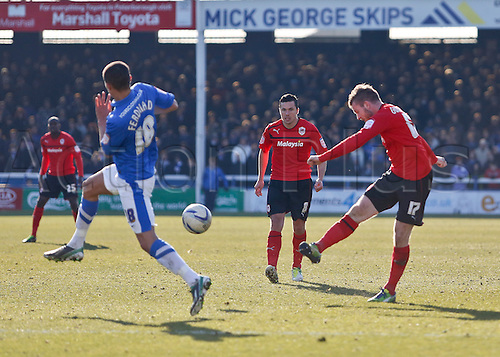 30.03.2013 Peterborough, England.  No.17 Gunnarsson of Cardiff City shoots on goal during the Championship game between Peterborough United and Cardiff City from London Road.