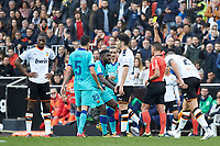25th January 2020; Mestalla, Valencia, Spain; La Liga Football,Valencia versus Barcelona; Referee Gil Manzano shows a yellow card to Defender Umtiti of FCB in minute 43'