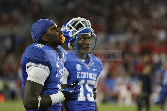 Ashely Lowery and J.D. Harmon show their dismay after WKU ties the score and puts the game into overtime during the University of Kentucky football game against Western Kentucky University, and Commonwealth Stadium in Lexington, Ky., on Saturday September 15th. Photo by Kirsten Holliday