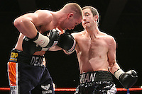 Paul McCloskey (Dungiven, black shorts) defeats Dean Harrison (Wolverhampton, dark blue/orange shorts) in a Light-Welterweight boxing contest for the British Title at Kingsway Leisure Centre, Widnes, promoted by Barry Hearn / Matchroom Sports - 13/03/09 -