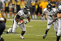 26 December 2010:  FIU running back Darriet Perry (28) carries the ball in the fourth quarter as the FIU Golden Panthers defeated the University of Toledo Rockets, 34-32, to win the 2010 Little Caesars Pizza Bowl at Ford Field in Detroit, Michigan.
