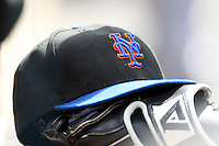 March 20, 2010:  Hat and glove of the New York Mets during a Spring Training game at Tradition Field in St. Lucie, FL.  Photo By Mike Janes/Four Seam Images