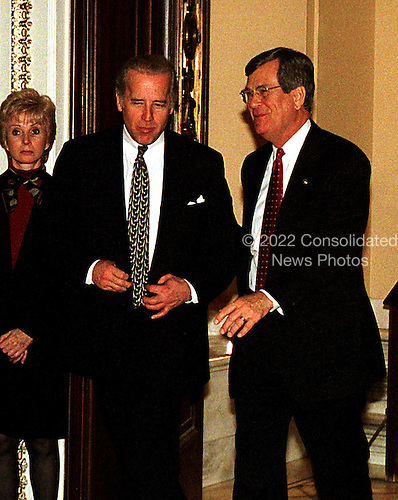 United States Senators Joe Biden (Democrat of Delaware), left, and Trent Lott (Republican of Mississippi), right, leave the U.S. Senate Chamber in the U.S. Capitol in Washington, D.C. during a break in the U.S. House presentation in the Impeachment Trial of U.S. President Bill Clinton on January 14, 1999..Credit: Ron Sachs / CNP