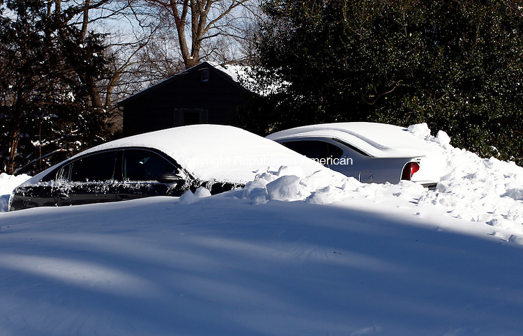 Naugatuck, CT- 09 February 2013-020913CM05- Many vehicles, like these on Timothy Road in Naugatuck were snowed in Saturday after a blizzard dumped more than two feet of snow in areas across the state.   Christopher Massa Republican-American