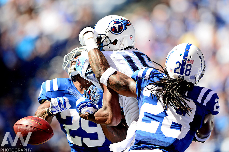 Sep 28, 2014; Indianapolis, IN, USA; Tennessee Titans wide receiver Justin Hunter (15) is unable to make a catch while being defended by Indianapolis Colts strong safety Mike Adams (29) and cornerback Greg Toler (28)during the second quarter at Lucas Oil Stadium. Mandatory Credit: Andrew Weber-USA TODAY Sports