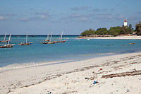 Nungwi, Zanzibar, Tanzania.  Beach, Fishing Boats in Harbor, Lighthouse in Background.