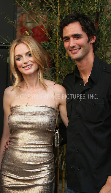 WWW.ACEPIXS.COM . . . . .  ....June 1 2011, New York City....Actress Heather Graham and Jason Silva arriving at the 'Kimchi Chronicles' launch party at Spice Market on June 1, 2011 in New York City. ....Please byline: PHILIP VAUGHAN - ACE PICTURES.... *** ***..Ace Pictures, Inc:  ..Philip Vaughan (212) 243-8787 or (646) 679 0430..e-mail: info@acepixs.com..web: http://www.acepixs.com