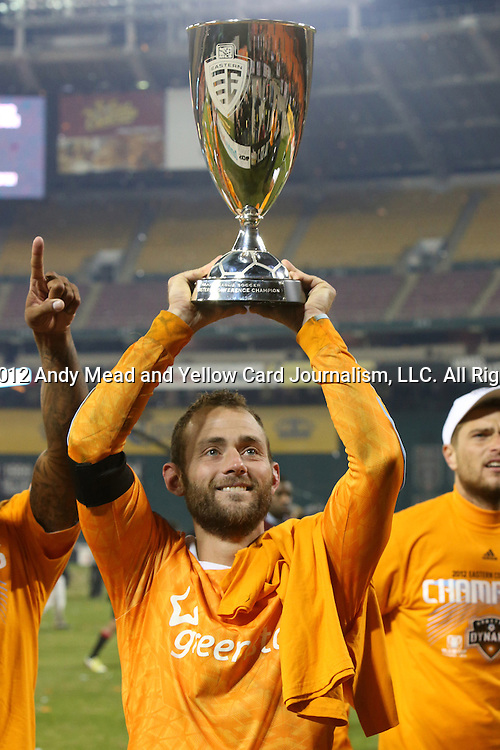 18 November 2012: Houston's Brad Davis holds the Eastern Conference Trophy up for the traveling fans to see. DC United played the Houston Dynamo at RFK Stadium in Washington, DC in the second leg of their 2012 MLS Cup Playoffs Eastern Conference Final series. The game ended in a 1-1 tie, Houston won the series 4-2 on aggregate goals.