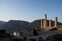 DELPHI, GREECE - APRIL 11 : A general view of the Sanctuary of Apollo at sunrise, on April 11, 2007, Delphi, Greece. From left to right, one can see the Sacred Way, the Polygonal Wall and the Altar of Chians, the East side of the Temple of Apollo with the ramp of ascent in the centre. The ruins of the Temple of Apollo belong to the 4th century BC, the third temple built on the site, still in the Doric order and completed in 330BC. Its architects were the Corinthians Spintharos Xenodoros and Agathon. (Photo by Manuel Cohen)